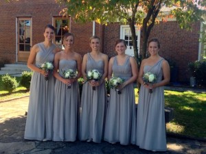 Beautiful bridesmaids waiting to be announced into the reception.