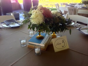 Centerpieces with antique books and containers.