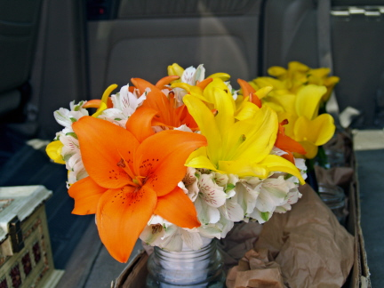 Bridal bouquet of orange and yellow asiatic lilies among white alstromeria