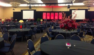 View of the large room with the tall vases, tall lamps,  short centerpieces and medium centerpieces.