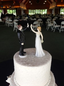 Loved her cake topper...the bride and groom figures are giving high-fives.