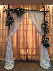 The bride wanted a non-symmetrical splash of color on the altar focal point.
