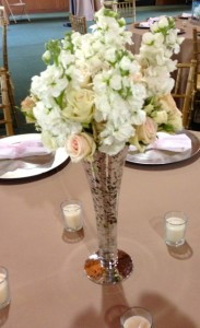Centerpieces of varying heights.
